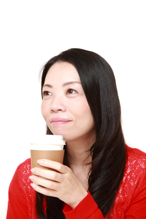 Japanese woman takes a coffee break photo