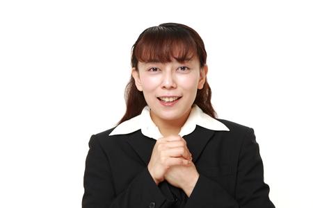 pleased: businesswoman pleased Stock Photo