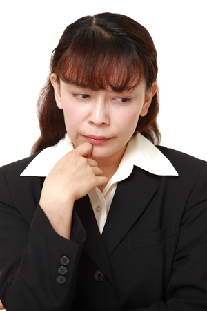 worries: businesswoman worries about something Stock Photo