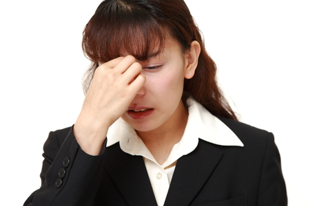 eyestrain: businesswoman suffers from Asthenopia Stock Photo