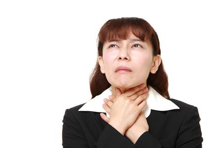 asian businesswoman having throat pain
