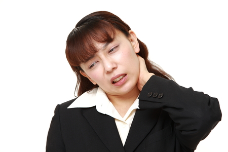 suffers: asian businesswoman suffers from neck ache Stock Photo