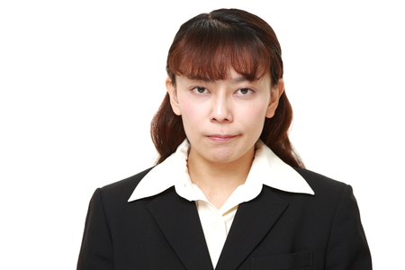 unattractive: asian businesswoman in a bad mood
