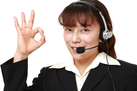 businesswoman of call center showing perfect sign photo