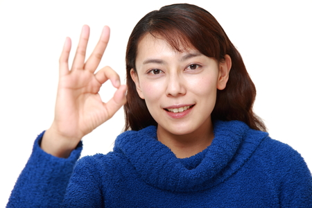 unattractive: asian woman showing perfect sign