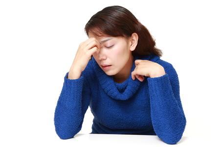 eyestrain: asian woman suffers from Asthenopia Stock Photo