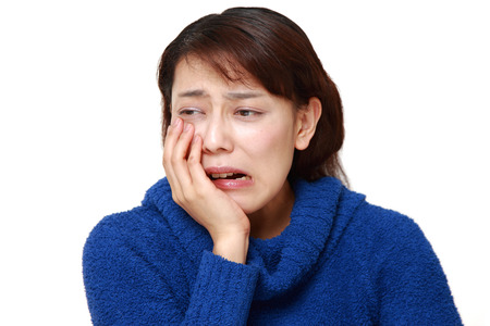 asian woman suffers from toothache Stock Photo
