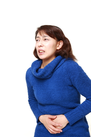 stomachache woman: asian woman suffers from stomachache Stock Photo