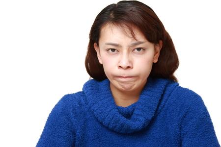 bad mood: asian woman in a bad mood Stock Photo