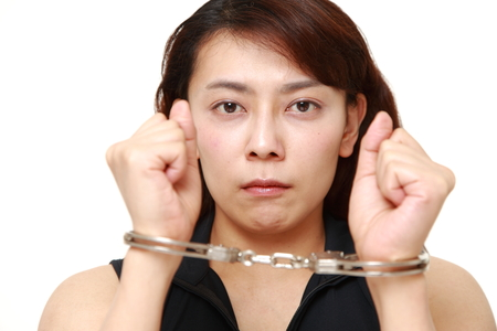 unattractive: arrested woman Stock Photo