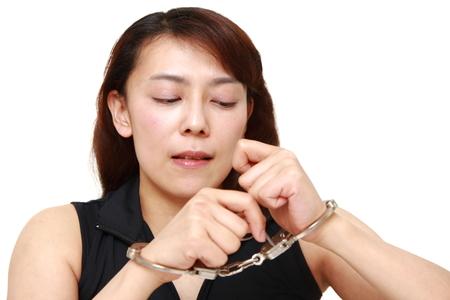 hoodlum: Woman trying to free herself Stock Photo