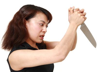 slasher: killer woman with knife Stock Photo