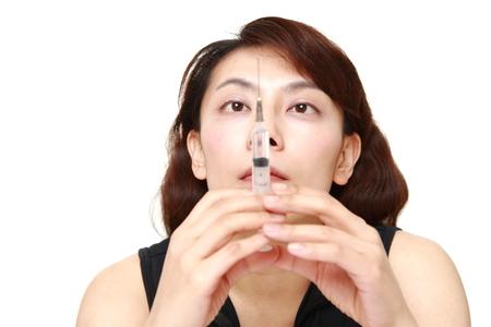 drug dealers: asian woman of drug addiction