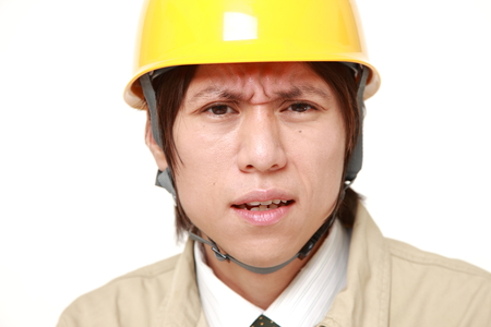 perplexed: perplexed construction worker Stock Photo