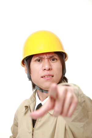 denunciation: young Japanese construction worker scolding