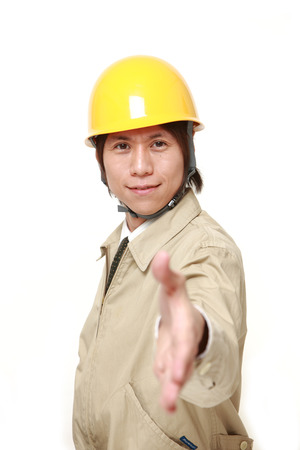 construction worker shake hands 写真素材