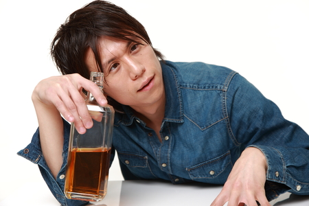 drunkenness: Young Japanese man drunk too much Stock Photo