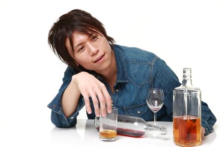 Young Japanese man drunk too much Standard-Bild