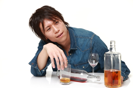 Young Japanese man drunk too much Stock Photo