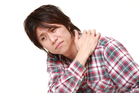 young Japanese man suffers from neck ache