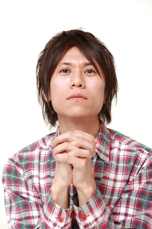 requesting: man folding his hands in prayer