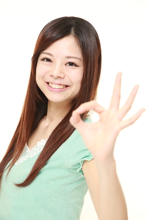 perfect sign: Japanese woman showing perfect sign Stock Photo