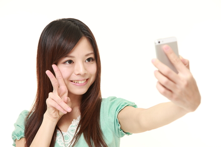 japanese people: Japanese woman takes a selfie