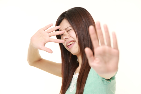 stop gesture: oung Japanese woman making stop gesture Stock Photo