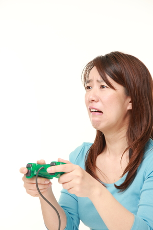 wimp: Japanese woman losing playing video game Stock Photo
