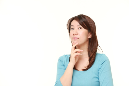 thinks: Japanese woman thinks about something Stock Photo