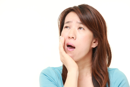 suffers: Japanese woman suffers from toothache
