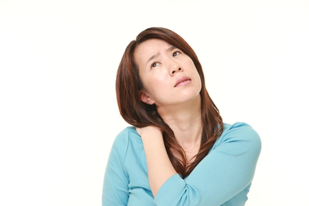 suffers: Japanese woman suffers from neck ache Stock Photo
