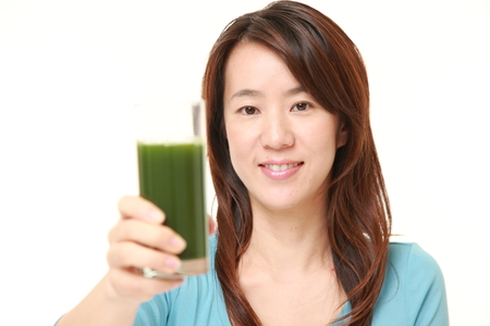green vegetable: japanese woman with green vegetable juice