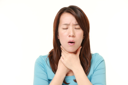 Japanese woman having throat pain