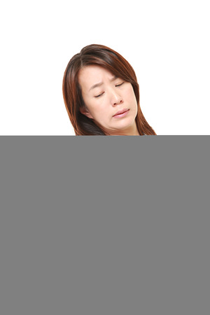 suffers: Japanese woman suffers from lumbago Stock Photo