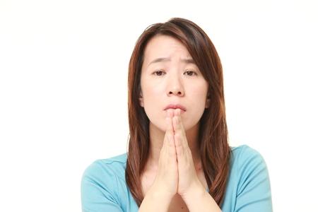 beg: woman folding her hands in prayer
