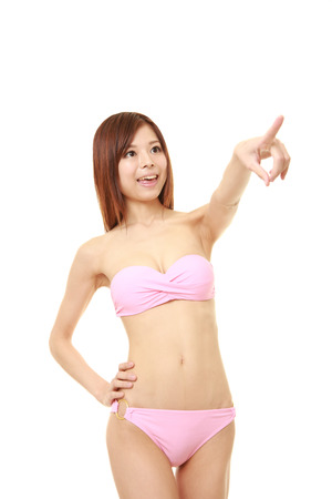 pink bikini: young Japanese woman in a pink bikini discover something