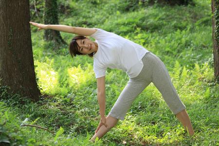 Japanese woman doing yoga triangle pose