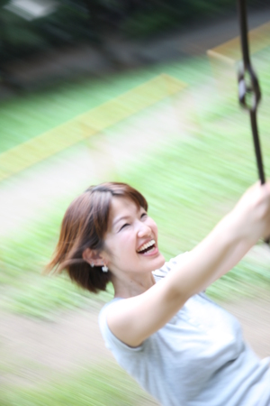 rides: young woman rides on the swing