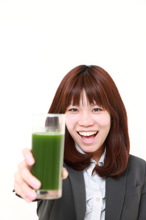 green vegetable: japanese businesswoman with green vegetable juice Stock Photo