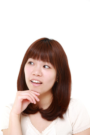thinks: young Japanese woman thinks about something