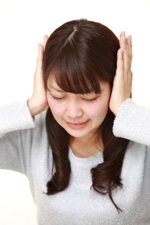 wry: Young Japanese woman suffers from noise