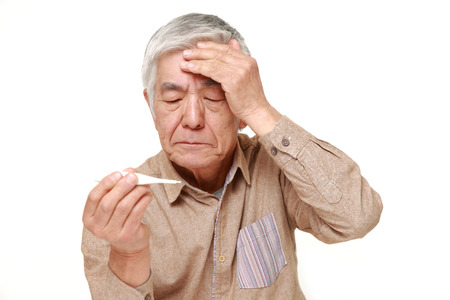 light complexion: senior Japanese man with fever Stock Photo