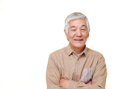 happy faces: senior Japanese man smiles