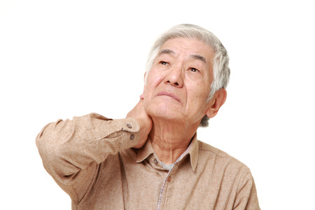 senior man on a neck pain: senior Japanese man suffers from neck ache