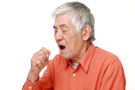 coughing: enior Japanese man coughing Stock Photo
