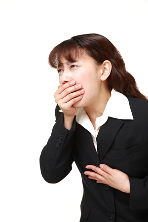 vomiting: asian businesswoman feels like vomiting
