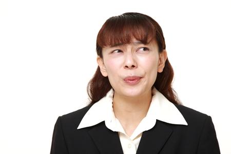 perplexed: perplexed Asian businesswoman