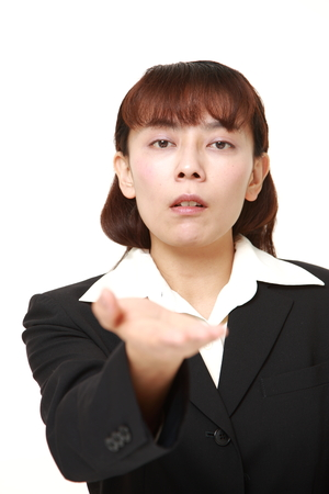 denunciation: angry Asian businesswoman requests something