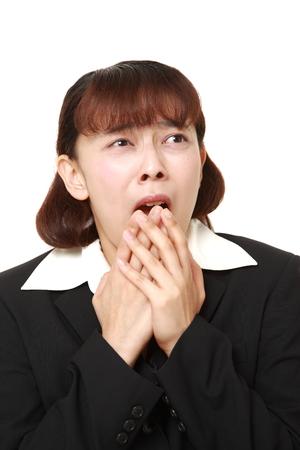 perplexed: Asian businesswoman perplexed